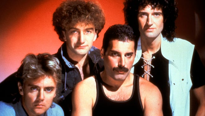 Freddie Mercury (mustache), Roger Taylor, John Deacon, and Brian May in Queen.