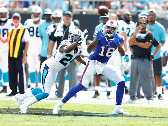 Buffalo Bills wide receiver Andre Holmes catches a pass while being defended by Carolina  cornerback James Bradberry during the second quarter on Sunday.