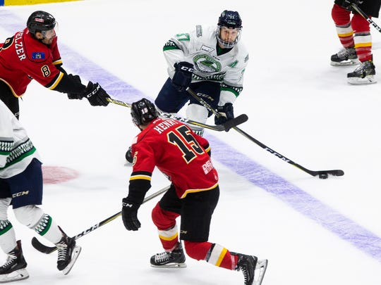 Florida Everblades defenseman Zack Kamrass handles the puck against the Adirondack Thunder defense during Game 2 of the Eastern Conference Finals at Germain Arena on Saturday, May 12, 2018.