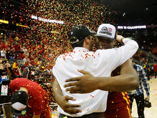 Iowa State guard Deonte Burton hugs coach Steve Prohm on March 11, 2017 after winning the Big 12 Conference Tournament at the Sprint Center in Kansas City.