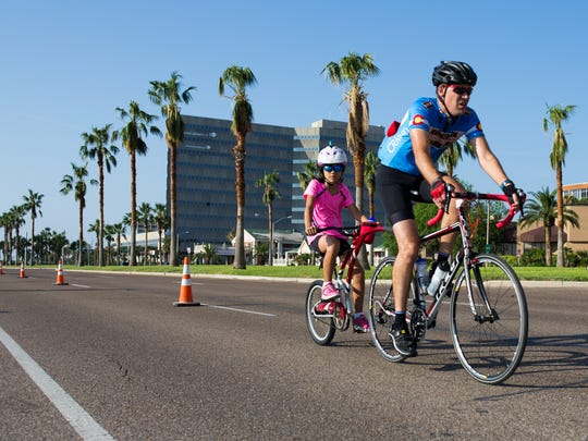 Riders bike on South Shoreline Boulevard as they take