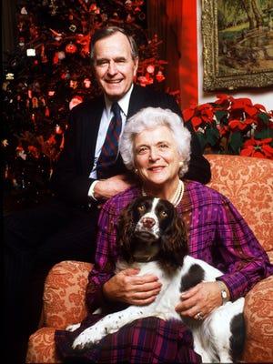 President George Bush, First Lady Barbara Bush and their dog Millie taken Dec. 1987.