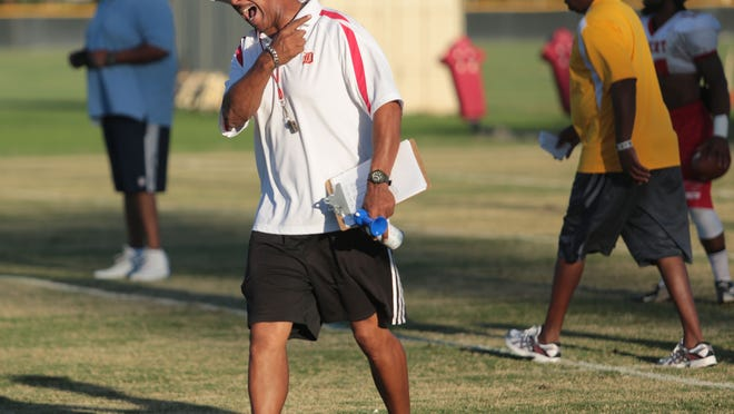 College of the Desert football coach Jack Steptoe works with his team during a practice in Palm Desert. Steptoe is honored at his induction into the Football Coaches Association Hall of Fame on March 13.