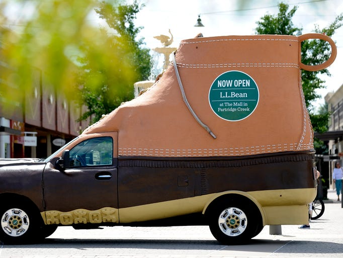 The L.L. Bean Bootmobile is parked in front of the
