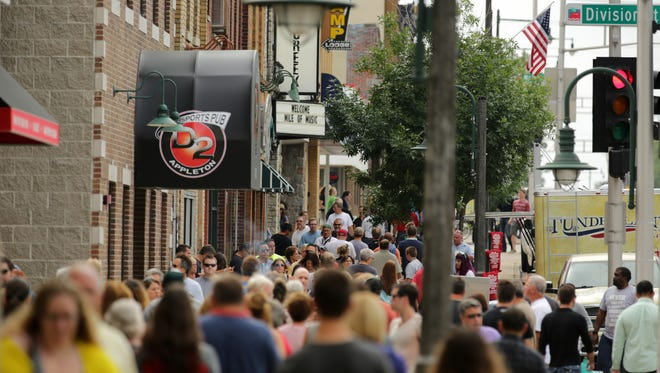 Music fans stream along College Avenue in downtown Appleton during Mile of Music.