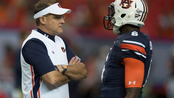 Auburn head coach Gus Malzahn talks to Auburn quarterback