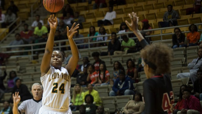 Jeff Davis' Tia Manora shoots over Central-Phenix City's Tatyana Lewis during the AHSAA Central Regional semi-final game on Wednesday, Feb. 17, 2016, at the Dunn-Oliver Academe in Montgomery, Ala.