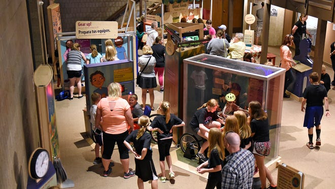 Children take part in several interactive parts of the Healthyville exhibit Thursday, May 26, at the Stearns History Museum in St. Cloud. The exhibit is designed for children and families and teaches aspects of healthy living. It will be on display until Labor Day.