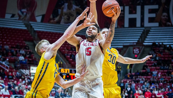 Ball State's fights for a shot past Toledo's defense during their game at Worthen Arena Tuesday, Jan. 31, 2017.