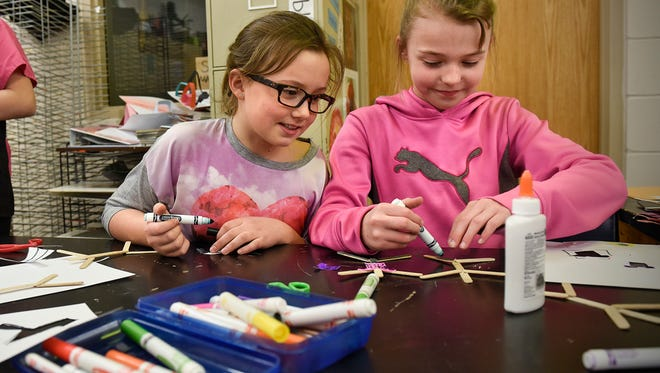 """Students create stick figure models reflecting their favorite careers during """"career day"""" activities Thursday, March 30 at KIDSTOP in Sauk Rapids. The event was one of several marking National Boys & Girls Club Week at 18 sites in Central Minnesota."""
