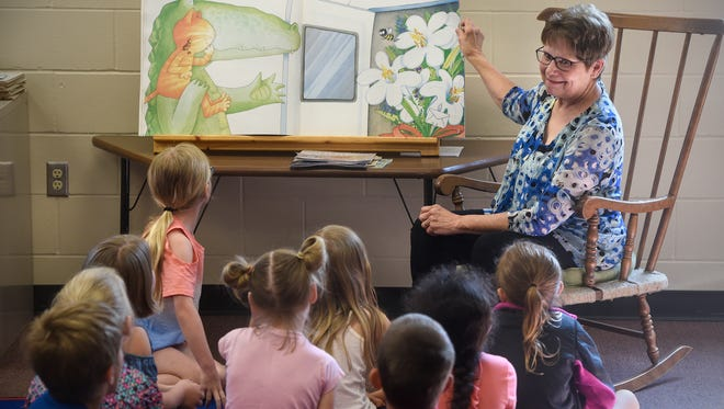 St. Boniface School first-grade teacher Carol Sell reads a book for her students during her last day of class Thursday, May 31, in Cold Spring. Sell has been a teacher at St. Boniface for 45 years.