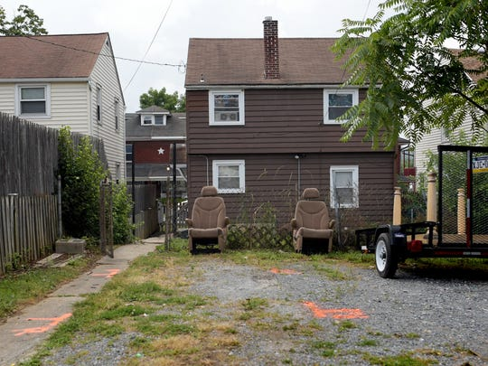 The parking are in the 900 block of West Locust Street where 22-year-old Elijah Shuler was gunned down July 4, 2018, by Timothy Pough, the ex-boyfriend of Shuler's sister.  (Bill Kalina photo)