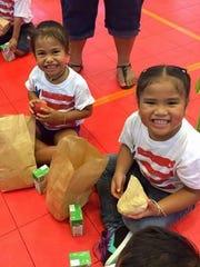 Reader Jocelyn Mendiola Ongesii shared this photo of Wettengel Elementary School's Head Start kids cheering during the program's 50th anniversary in 2015.