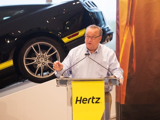 John Tague, the CEO of the Hertz Global Corporation in Estero  speaks at the headquarters celebration on Friday.  The building was opened to the media and dignitaries.  Florida Gov. Rick Scott was present and spoke as well.