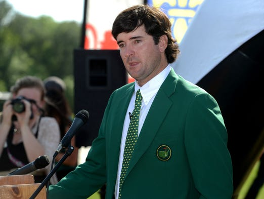 Two-Time Masters Champion Bubba Watson talks to young golfers in the First Tee of Northwest Florida program Thursday at Osceola Municipal Golf Course.