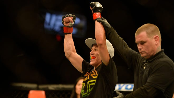 Lafayette native Liz Carmouche celebrates after defeating Lauren Murphy on April 4, 2015, during UFC Fight Night in Fairfax, Virginia.
