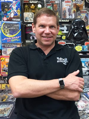 "Joel Magee, nicknamed ""America's Toy Scout,"" is pictured with his Star Wars collection of memorabilia."