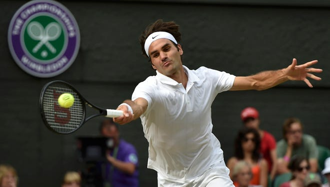 Roger Federer of Switzerland, shown here hitting a return in his victory Wednesday over countryman Stanislas Wawrinka, is playing dominant tennis on grass again.