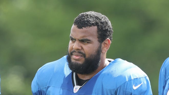 Detroit Lions guard Larry Warford watches drills during training camp Monday, August 1, 2016 at the practice facility in Allen Park, MI.