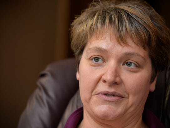 Pam Hansen talks at her home Nov. 17 about her decision