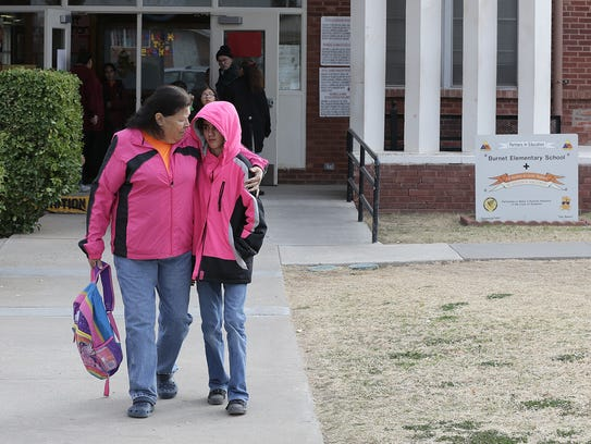 Armida Gomez picks up her daughter, Isabella Spaulding, 9, a fourth-grader at Burnet Elementary School, on Tuesday afternoon. Isabella is a fourth-generation student at the Northeast El Paso campus that will close at the end of the school year.