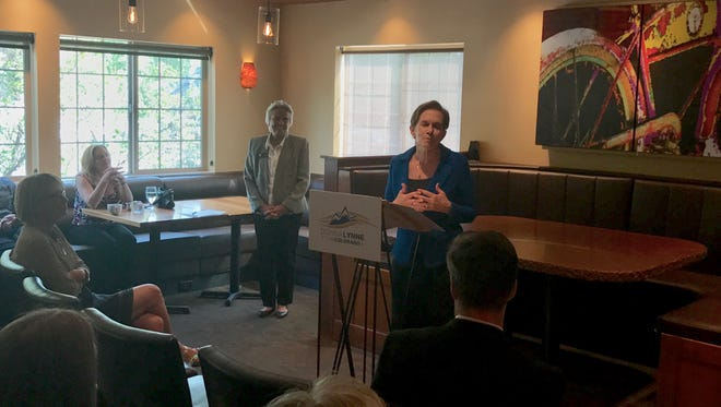 Lt. Gov. Donna Lynne, center, speaks at Cafe Vino in Fort Collins on Thursday while state Rep. Joann Ginal, D-Fort Collins, looks on. Lynne announced her candidacy for governor in Denver shortly before heading north.