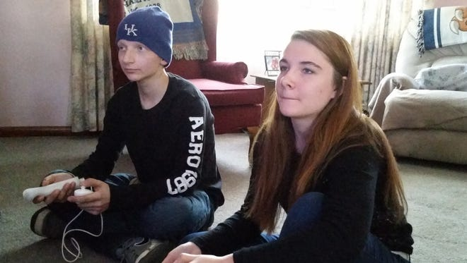 Thomas Judd playing video games with his sister Courtney. Thomas is battling nasopharyngeal carcinoma for the third time.