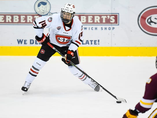 St. Cloud State's Patrick Newell makes a pass against