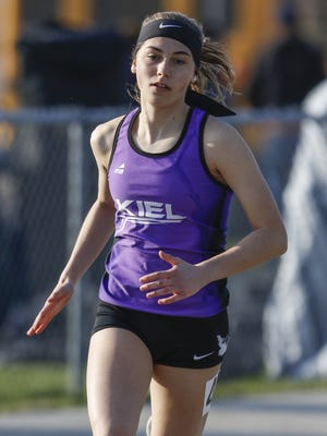 Kiel's Sydney Binversie runs the 400 meter dash at the Reedsville Track Invitational on April 13 at Reedsville.