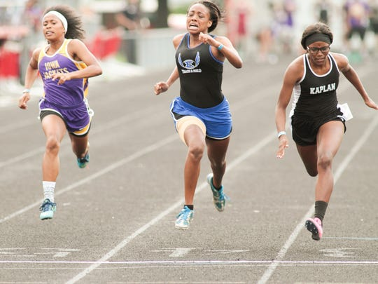 Kaplan's Tory Riggs nudges out Erath's Lindsay Darby to win the 100 meter dash during the 3A regional track meet Thursday at Wildcat Field in Abbeville.