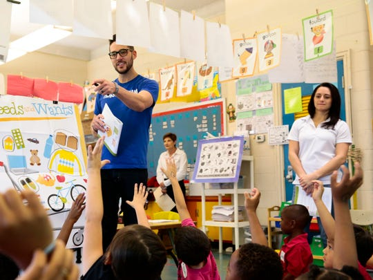 Marketing strategizer Patrick LaBauve of The Daily Advertiser calls on kindergarten students at Prairie Elementary School during Junior Achievement' of Acadiana's Financial Literacy Day in Lafayette May 4, 2016.