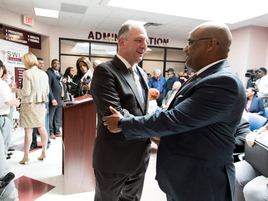 Gov. John Bel Edwards greets Marcus Bruno, assistant to Mayor-President Joel Robideaux, after Edwards addressed his roll out of Medicaid expansion at the Southwest Louisiana Health Services Center in Lafayette May 11, 2016.
