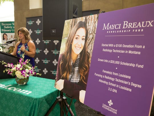 Dondie Breaux, mother of Mayci Breaux, speaks during