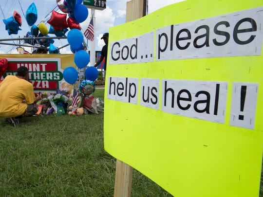 A sign calling for healing at a makeshift memorial July 18, 2016 at the site of a shooting that left three policemen killed and three wounded in Baton Rouge July 17.
