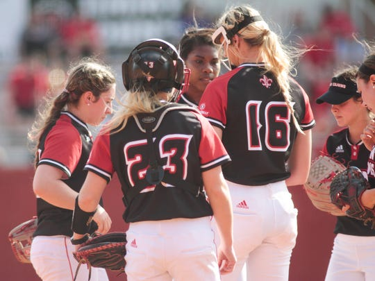 UL pitcher Alyssa Denham and the Cajuns have a meeting in the circle during Sunday's two losses to USM at Lamson Park.