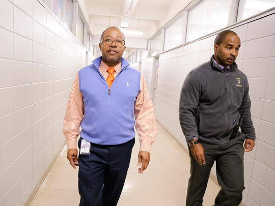 St. Landry Superintendent Patrick Jenkins walks with principal Milton Batiste III  during his visit to Lawtell Elementary Tuesday, March 14, 2017.