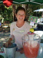 Gloria Oliver serves her famous Pink Bikini punch.