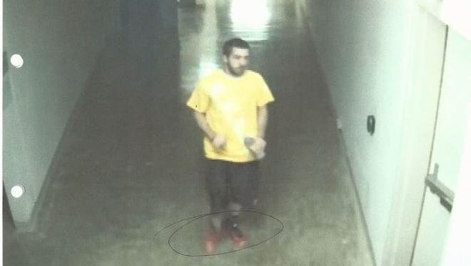 This male suspect allegedly stole a yellow T-shirt and water bottle April 11.