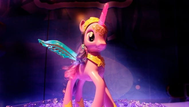 Princess Twilight Sparkle is one of the My Little Pony characters. The toys feature a unicorn-like horn.