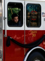 Family members rode in fire department vehicles to