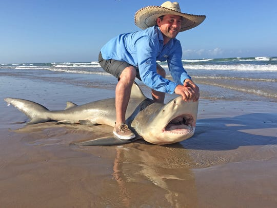 "Aaron Martin, of Rogers, caught this 8-foot bull shark while fishing with surf guide Eric ""Oz"" Ozolins around the 40-mile marker on Padre Island National Seashore."