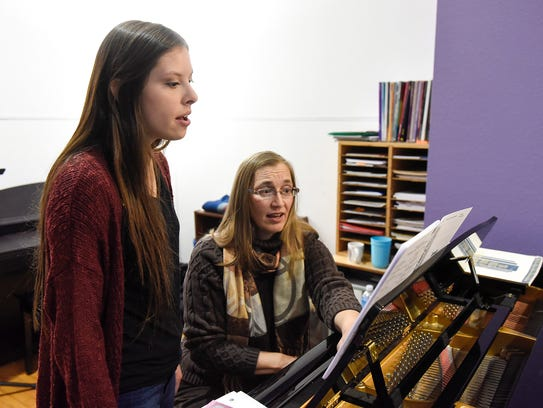 Ashley Gonzalez works with singing instructor Marcie