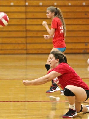 A Palm Springs High School player attempts to handle a serve during the team's practice session on Sept. 9, 2015.