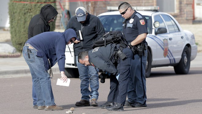 El Paso police officers investigate a shooting in the 10300 block of Pasadena Circle in Northeast on Thursday. Police said the target of the shooting, who was not hit, is not cooperating.