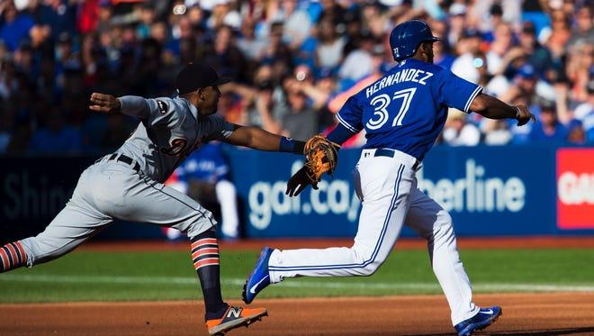 Blue Jays leftfielder Teoscar Hernandez is caught stealing by Tigers shortstop Dixon Machado in the fourth inning Saturday, Sept. 9, 2017, in Toronto.