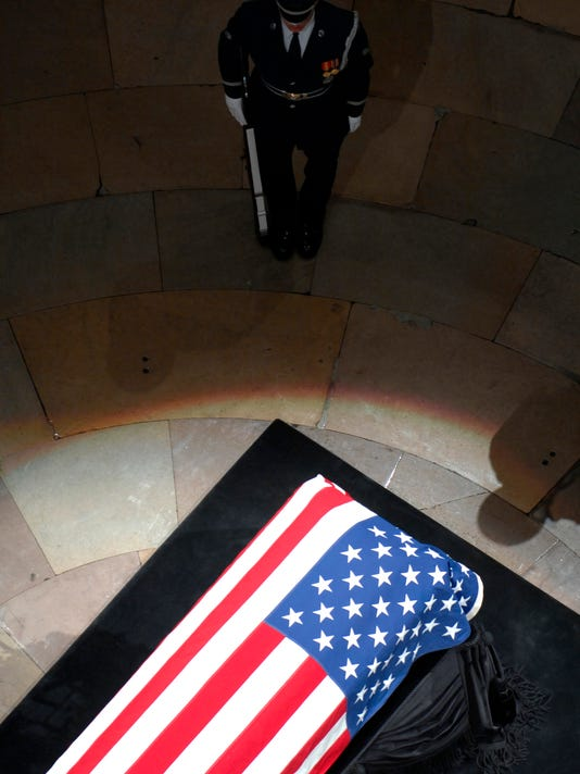 A lone U.S. Air Force Honor Guardsman stands watch over the casket of former President Gerald R. Ford in the Capitol Rotunda in Washington, D.C., January 1, 2007.
