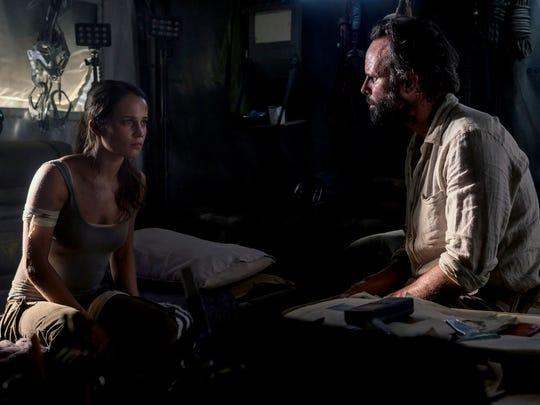 "Lara (Alicia Vikander) meets rival adventurer Mathias Vogel (Walton Goggins) in ""Tomb Raider."""