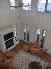 The two-story family room has a gas fireplace and a