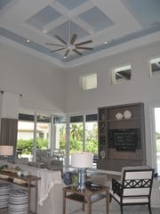 High ceilings with puzzle like inserts tower over the