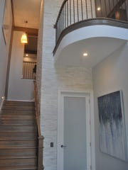 The entry to the upstairs units offers stairs and an
